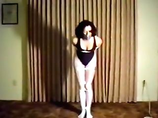Woman Tied In Black Leotard And Milky Stocking